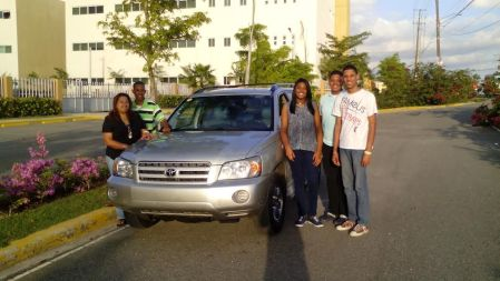 Martires and his family with the SUV that they were able to purchase with the Year End gift from High Point Church.