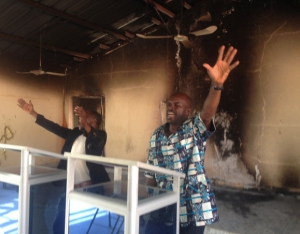 Nigerian Pastor Nelson Nwene continues to preach and worship in a church building bearing scorch marks from an attack in early January 2015.